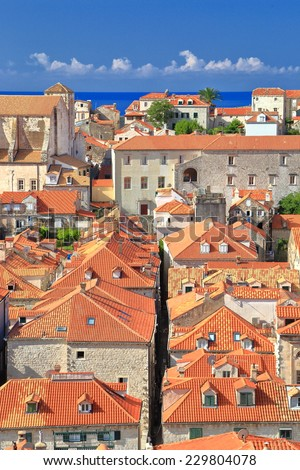 Narrow street between orange roofs in the old town of Dubrovnik, Croatia - stock photo
