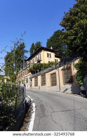 Narrow street from Brunate village near town of Como,Italy. - stock photo