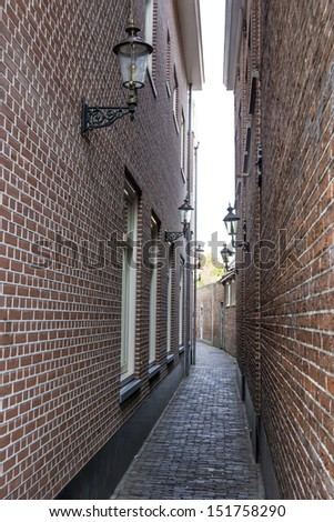 Narrow street, Haarlem, the Netherlands - stock photo