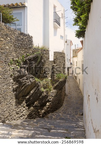 Narrow street in a small Mediterranean village. Cadaques, Costa Brava, Catalonia, Spain - stock photo