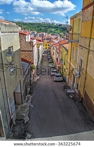 narrow street in a small town in Sardinia, Italy - stock photo