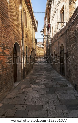 narrow street in a village in central Italy
