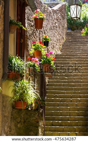 Narrow street in ancient town of Volterra, Tuscany, Italy