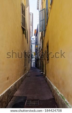Narrow street in Bayonne, France - stock photo