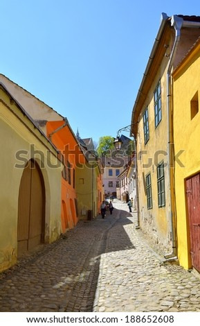 Narrow street in medieval city Sighisoara, Transylvania, Romania