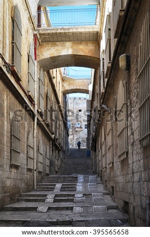 Narrow street in old City of  Jerusalem, Israel. Jerusalem is a Capital of Israel, one of the oldest cities in the world and one of the foremost pilgrimage destination. - stock photo