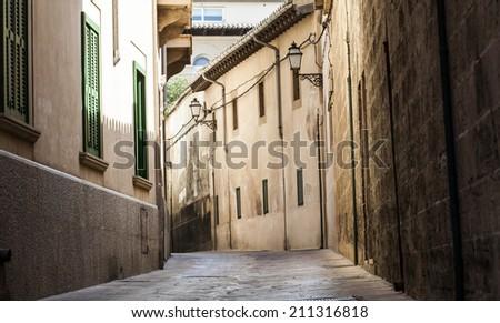 Narrow street in old city of Palma de Mallorca, Spain - stock photo