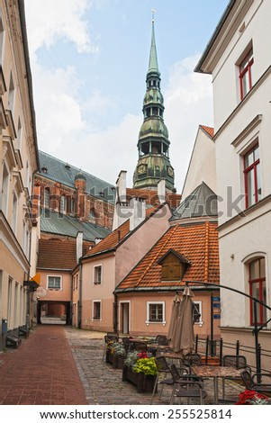 Narrow street in old city of Riga, Latvia  - stock photo