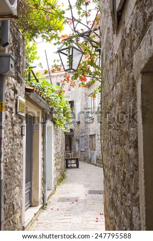 narrow street in old district of Budva, Montenegro - stock photo