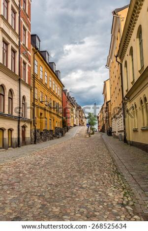 Narrow Street in Old Town (Gamla Stan) of Stockholm, Sweden - stock photo