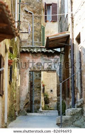 Narrow street in Pitigliano, Tuscany, Italy - stock photo