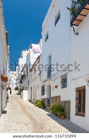 Narrow street in Spanish village - stock photo