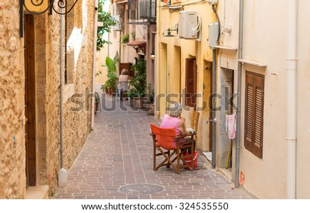 Narrow street in the center of Chania. - stock photo