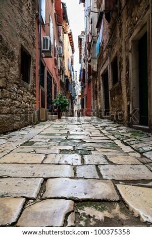 Narrow Street in the City of Rovinj, Croatia - stock photo