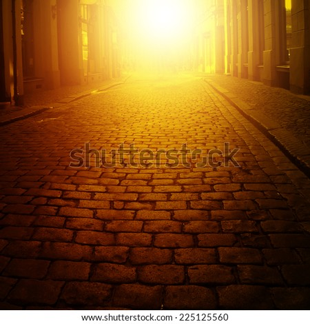 Narrow street in the european city at sunset.  - stock photo