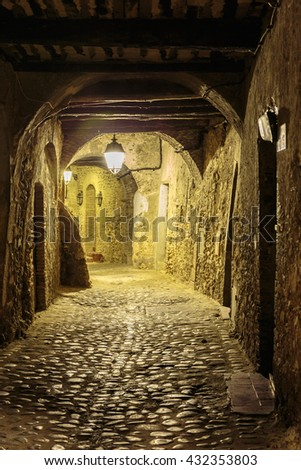 Narrow street in the old town Eze in France at night