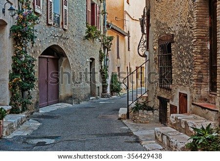 Narrow street  in the old town  in France. - stock photo