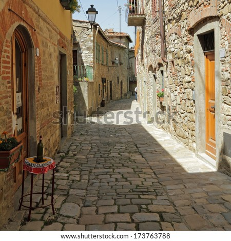 narrow street in tuscan village Montefioralle,  sometimes claimed to be the birthplace of Amerigo Vespucci,  Greve in Chianti, Italy, Europe - stock photo