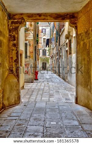 Narrow street in Venice - stock photo