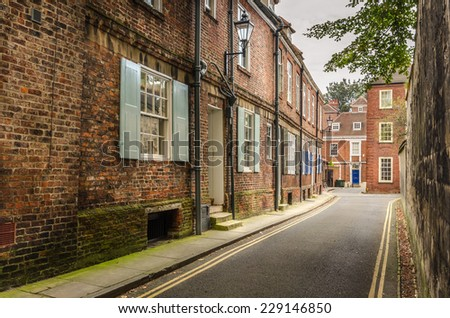 Narrow Street Lined with Terraced Houses - stock photo
