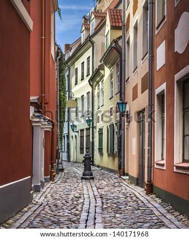 Narrow street of medieval town in Riga city - capital of Latvian Republic, Europe - stock photo