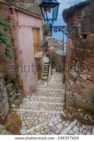 Narrow street of old fortress of Forsa d'Agro. Sicily, Italy - stock photo