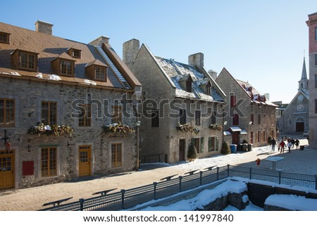 Narrow street of Old Quebec city in winter - stock photo