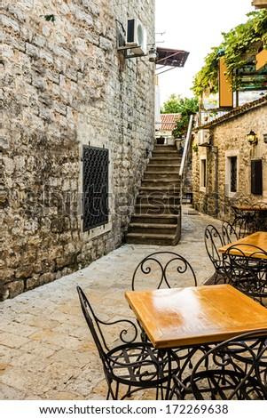 Narrow street of old town Budva , Montenegro - stock photo
