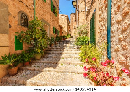 Narrow street old traditional houses village flowers, Fornalutx, Majorca island