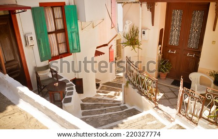 Narrow street, stairs and doors in Vathi, Samos, Greece - stock photo