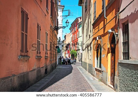 Narrow street with colorful architecture in Parma, Emilia Romagna region, Italy. Summertime.