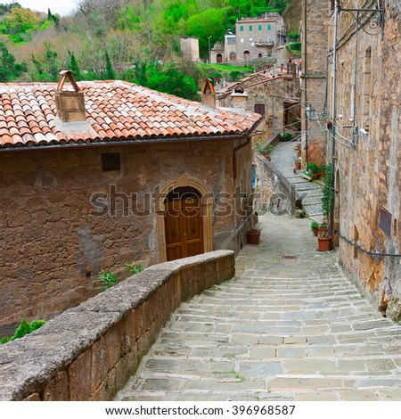 Narrow Street with Old Buildings in Italian City of Sorano