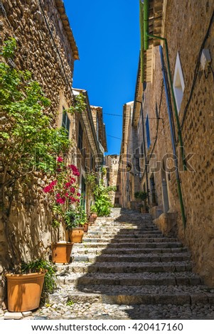 Narrow street with traditional stone houses in Fornalutx, Majorca, Spain, Europe
