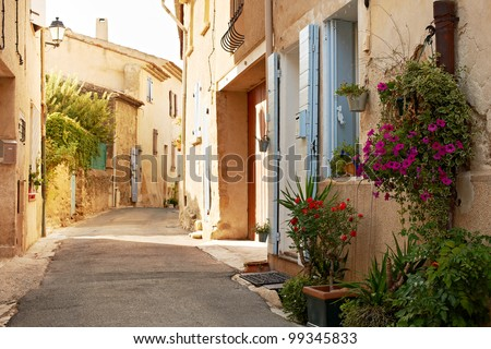 Narrow street with typical houses in village of Ansouis, Provence, France, region Luberon