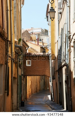 Narrow street with typical medieval buildings in Aix en Provence town, South France - stock photo