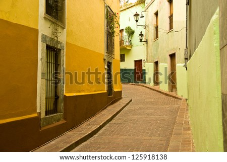 Narrow streets in the city center of  Guanajuato, Mexico, a UNESCO World Heritage Site. - stock photo