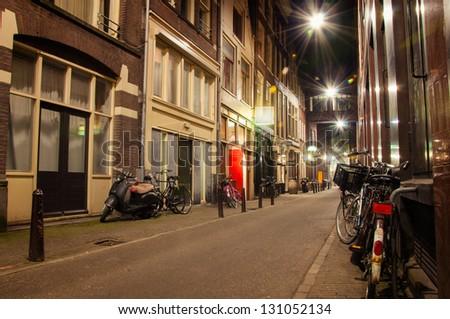 narrow streets of Amsterdam at night - stock photo
