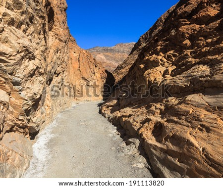 Narrow trail through Mosaic Canyon in Death Valley National Park, California.