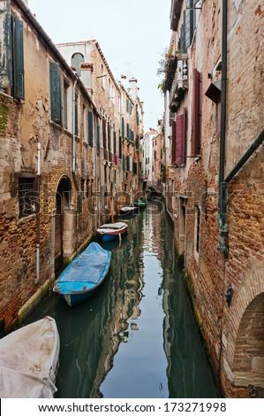Narrow Venetian canal in a sunny day - Venice, Italy - stock photo