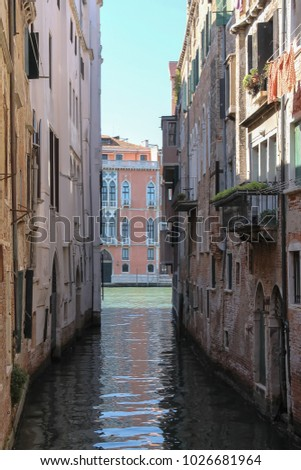 Narrow water street of historic center of Venice, San Marco. Italy