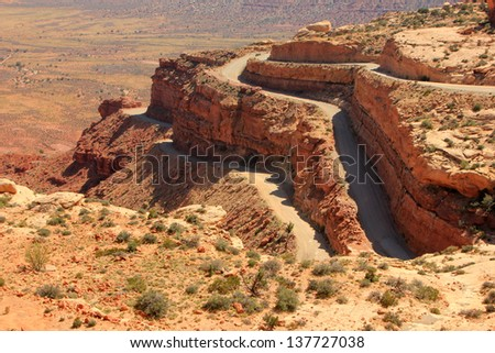 Narrow winding road in the Utah desert, USA. - stock photo