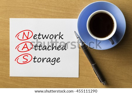 NAS Network Attached Storage - handwriting on paper with cup of coffee and pen, acronym business concept