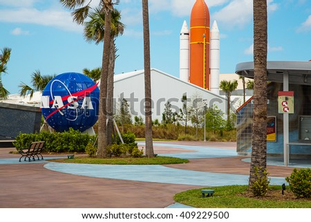 Nasa space center in Florida with the Nasa logo and a rocket on the background.  - stock photo