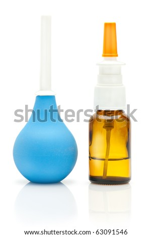 Nasal spray bottle and rubber medical pear isolated on white background - stock photo