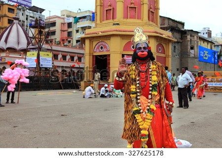 NASHIK - SEP 14:An unidentified devotee appear as the Hindu God Hanuman during the event Kumbh Mela on September 14, 2015 in Nashik, India.Kumbhmela is a Hindu religious event gathered by millions. - stock photo