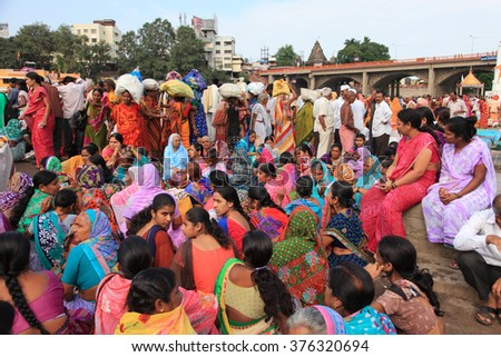 NASHIK - SEP 15:Unidentified devotees come to bath in the river Godavari during the event Kumbh Mela on September 15, 2015 in Nashik, India.Kumbhmela is a Hindu religious event gathered by millions. - stock photo