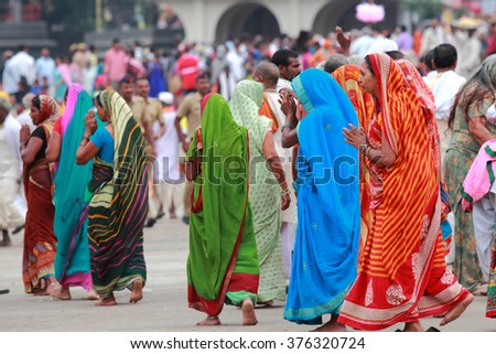 NASHIK - SEP 14:Unidentified devotees come to bath in the river Godavari during the event Kumbh Mela on September 14, 2015 in Nashik, India.Kumbhmela is a Hindu religious event gathered by millions. - stock photo