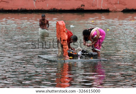 NASHIK - SEP 14:Unidentified devotees do rituals in the river Godavari during the event Kumbh Mela on September 14, 2015 in Nashik, India.Kumbhmela is a Hindu religious event gathered by millions. - stock photo