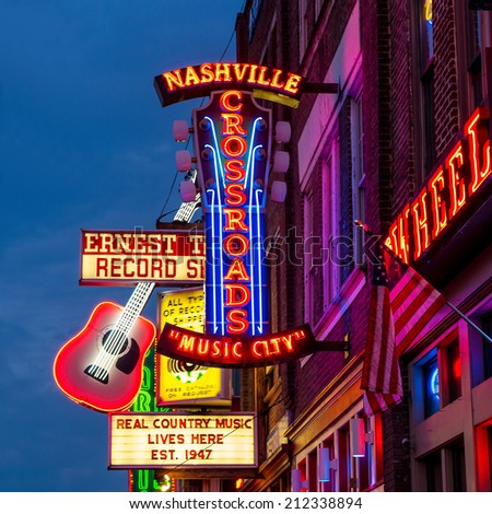 NASHVILLE - AUGUST 1: Neon signs on Lower Broadway Area on August 1, 2014 in Nashville, Tennessee, USA - stock photo
