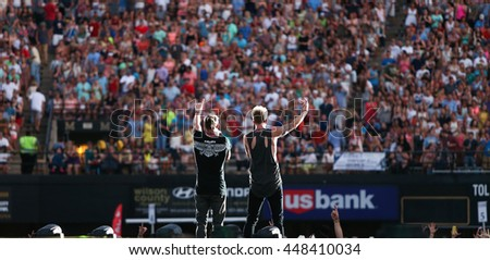 NASHVILLE-JUL 11: Singers Tyler Hubbard (L) and Brian Kelley of Florida Georgia Line perform during the 'Kick The Dust Up' Tour at Vanderbilt Stadium on July 11, 2015 in Nashville, Tennessee.